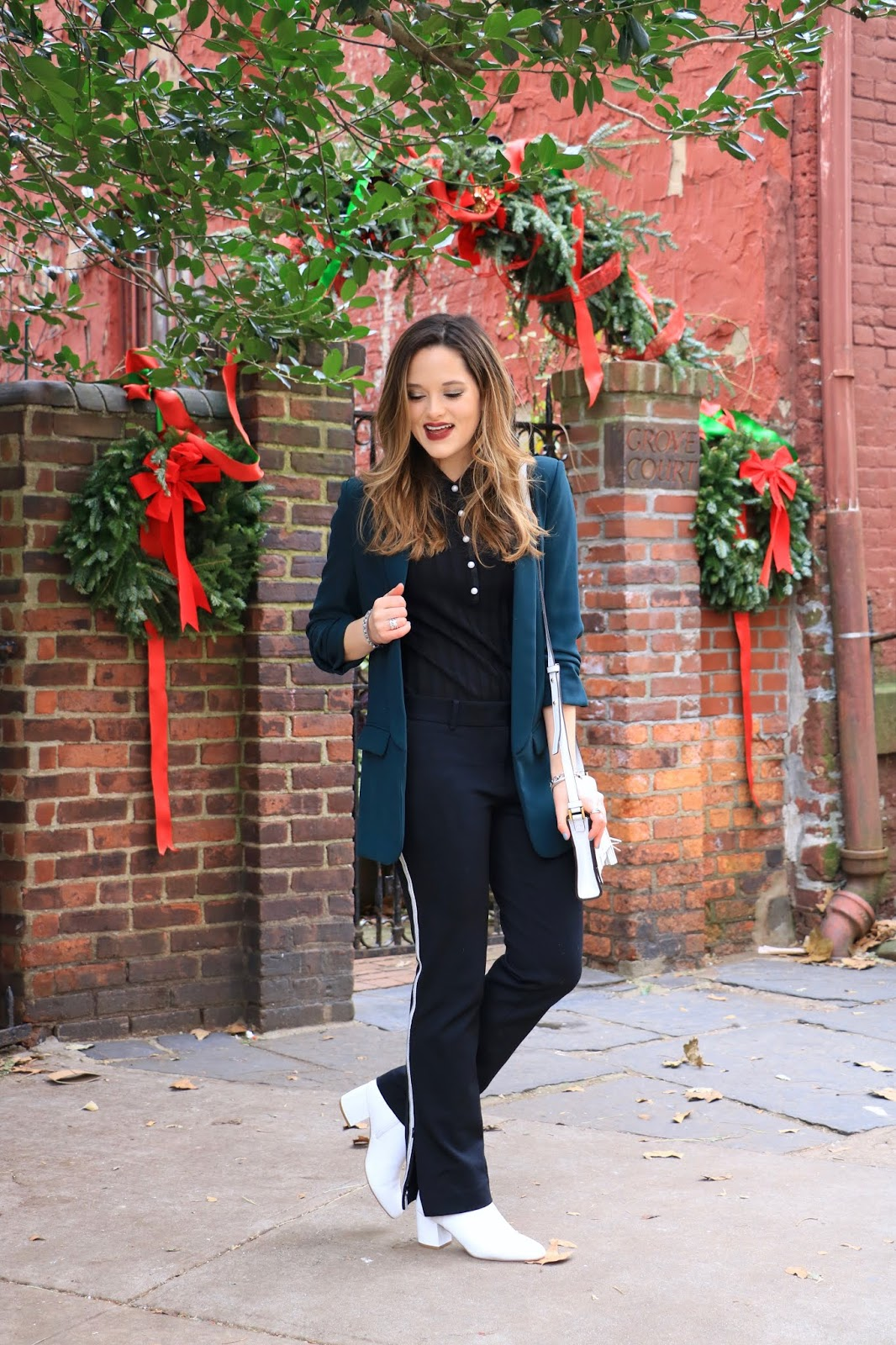 Nyc fashion blogger Kathleen Harper showing how to wear formal track pants