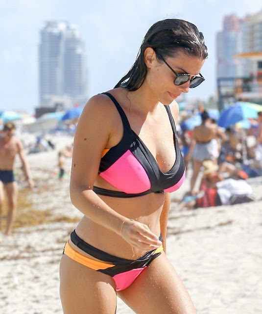 Ludivine Sagna into neon bikini on the beach in Miami