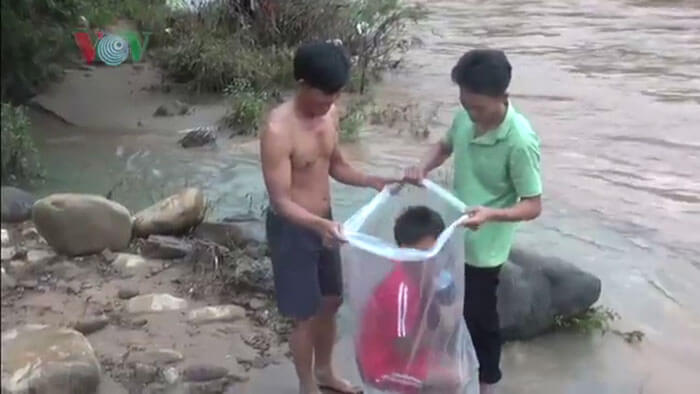 Students In Vietnam Village Ferried Across A River In Plastic Bags To Go To School