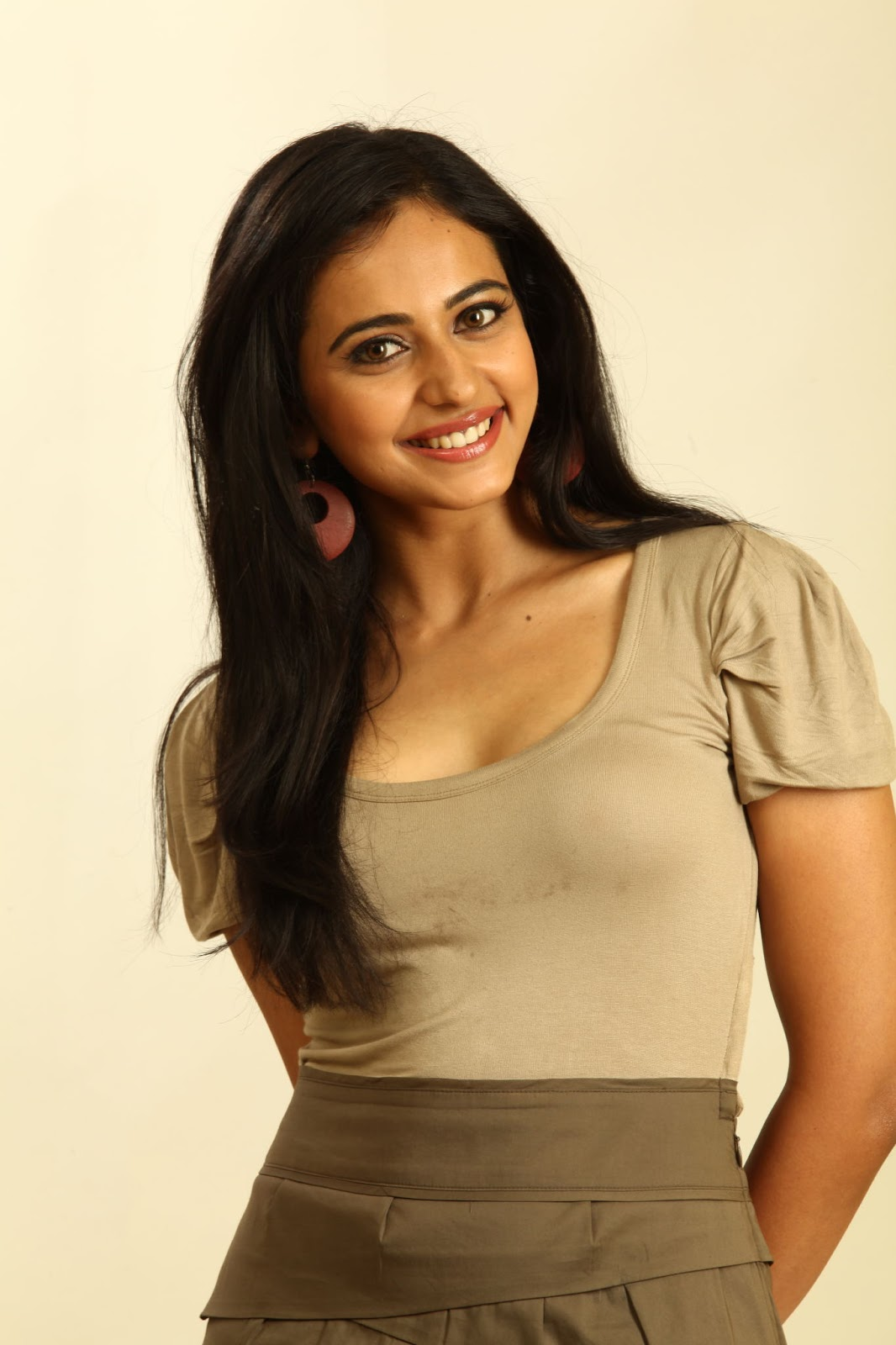 Rakul Preet Singh Teeths Show Smiling Photos