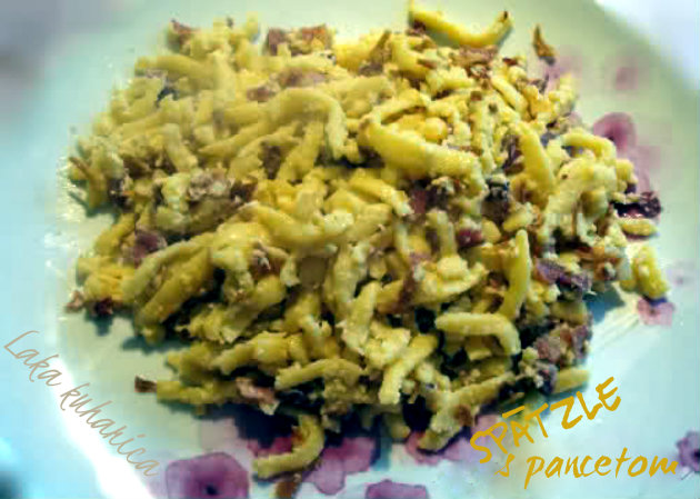 Spätzle with pancetta. German little dumplings combined with pancetta and fried onion make this delicious easy dish.