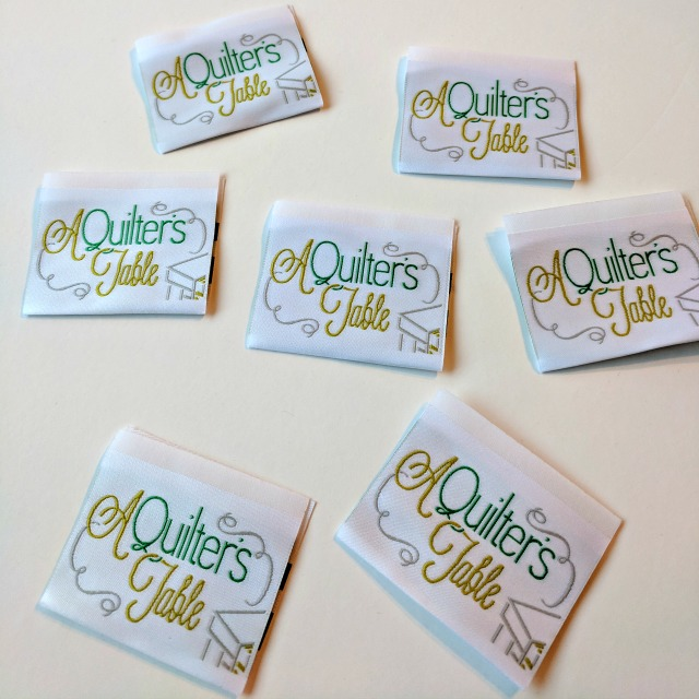 A Quilter S Table Logo Labels