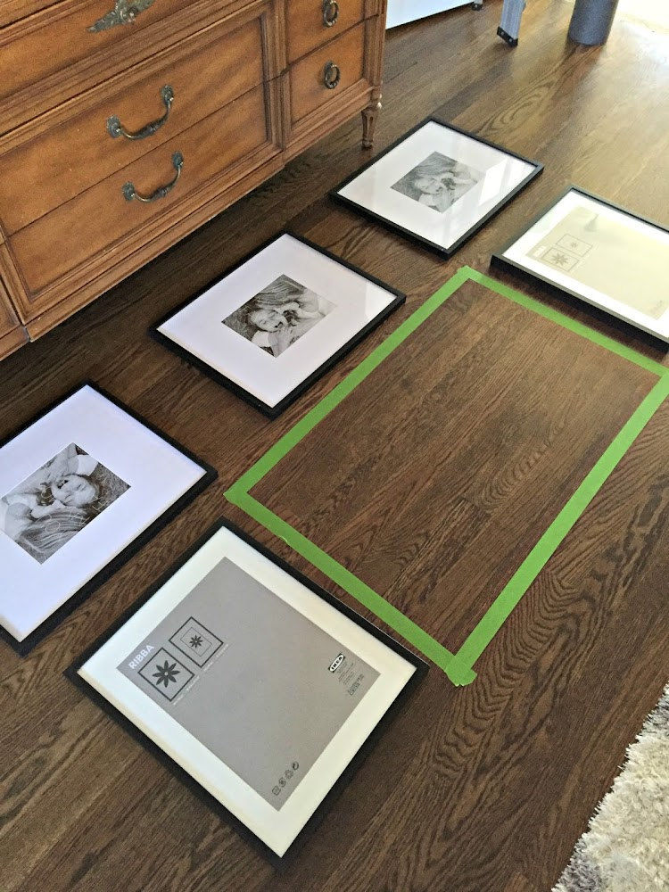laying out gallery wall on floor