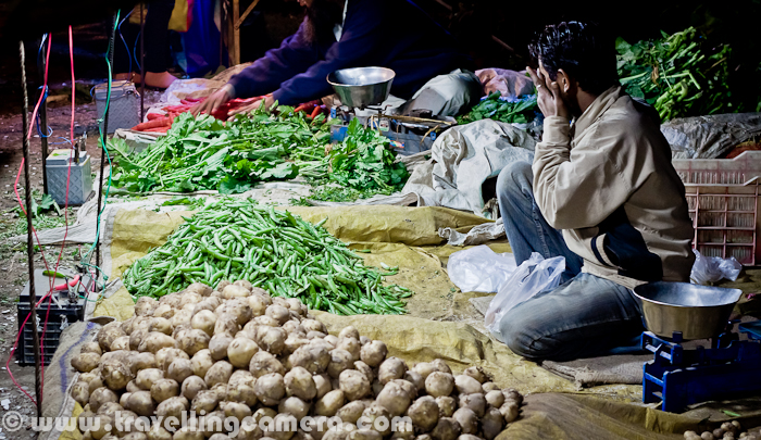 During Christmas vacations, I was in Chandigarh and was staying with Naresh at Mohali. So on thursday, we visited one of the vegetable market at Phase-3B2, mohali and found this little interesting... Let's check out this Photo Journey from this weekly Vegetable Market...Clicking photographs in such markets is not a usual thing and at times, vegetable vendors don't like (which can be interpreted from their expressions.) So we have clicked photographs of shops/kiosks, where we bought something.In most of the big cities/towns of India, there is a trend of weekly vegetable markets. At some places, farmers from surrounding areas come with fresh vegetables to a common ground. While in cities  around Capital region, vegetables vendors come up with various vegetable options picked from main store.In cities like Mohali, Chandigarh are closer to agricultural regions, so have an advantage of accessing fresh vegetables and fruits. In fact, lot of local stuff is also available quite easily...It was wonderful experience to roam around a place with all fresh vegetables, fruits and other local stuff. People from villages calling the customers with extreme humbleness and many times, no need of negotiations. They sell vegetables, fruits, sugarcane etc at very reasonable rates. Most of the vendors deal only in selected items. For example, vegetable vendor in this photograph is only selling potatoes and peas.Colorful vegetables lying across the rows in this market @ Mohali, Punjab, India.Freshness of these vegetables or fruits, at times, compel to overbuy due to cheaper rates. So it's always important to know the need, before heading towards these markets. It's always tempting to stop by every kiosk and ask for rates and fill the bags :) ... I know it's not possible to estimate the amount and type of vegetables/fruits required for next few days, but it becomes important when you are shopping at these moving markets and not supermarkets around your house.Please have a look at http://spi