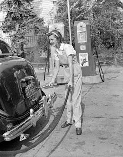 woman pumping gas