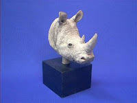 Sandicast Rhino Figurine Faces Nature