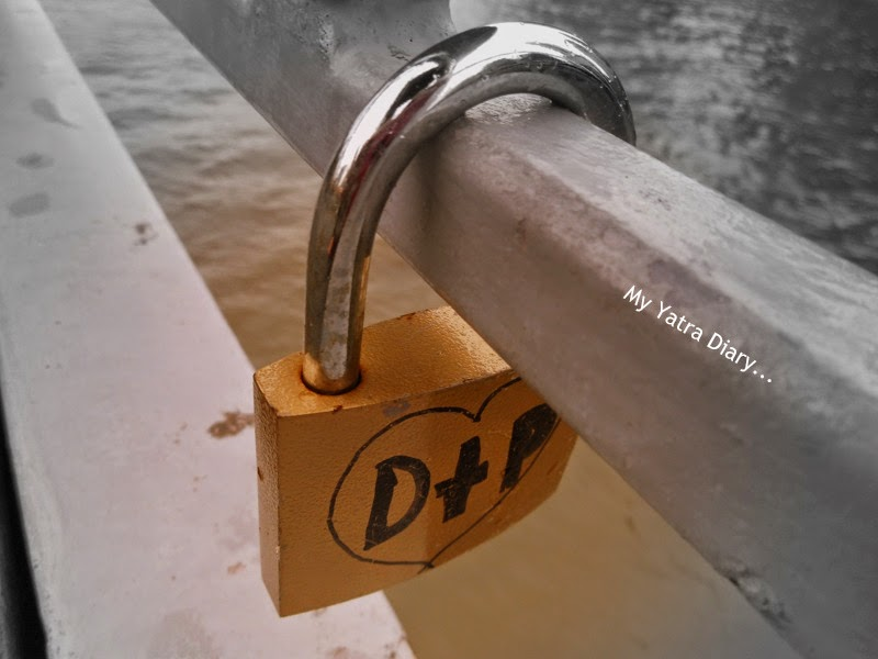 Love padlocks along the Yarra River footbridge, Melbourne in Australia