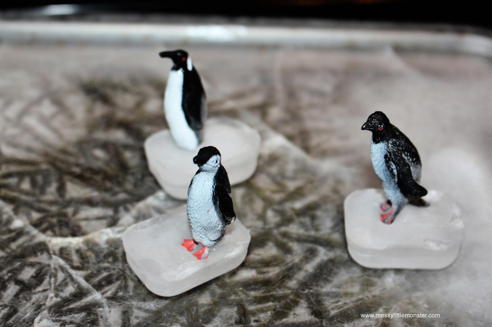 sensory play for toddlers. How to make a diy ice rink to create an ice skating penguin small world.