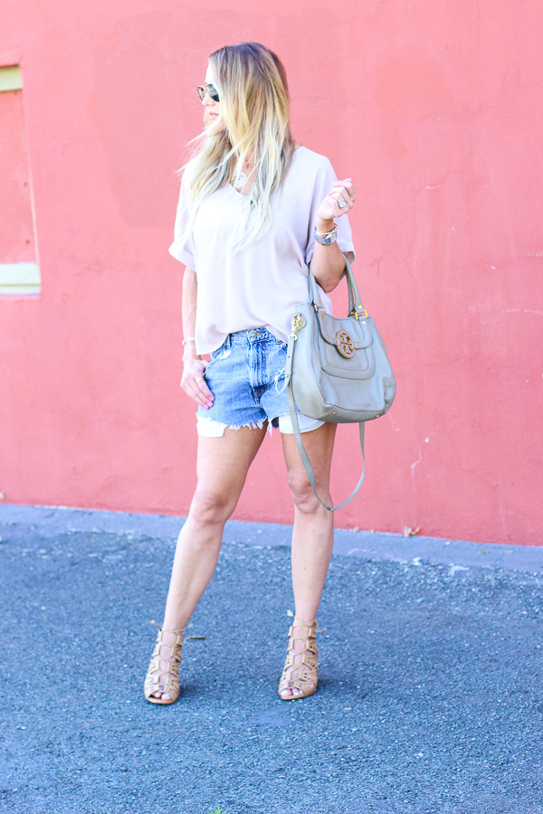 feminine top with denim cutoffs distressed