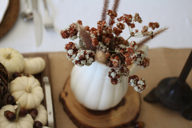 natural fall tablescape with white ironstone pitchers and white pumpkins