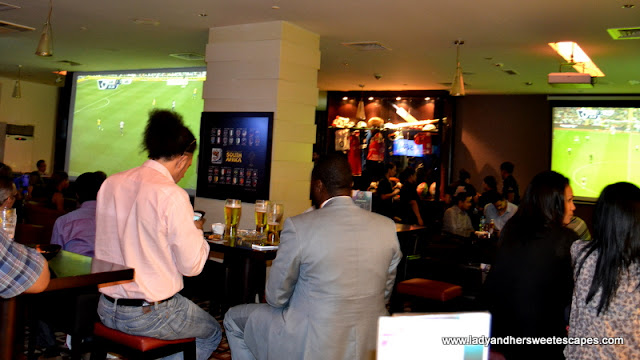 sports enthusiasts at The Huddle Sports Bar And Grill in Citymax Hotel Burd Dubai