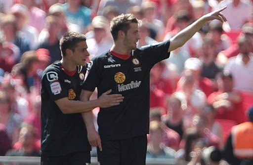 Crewe striker Nick Powell celebrates his goal against Cheltenham with a teammate