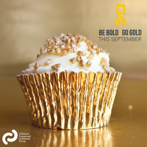 A cupcake with Gold sprinkles