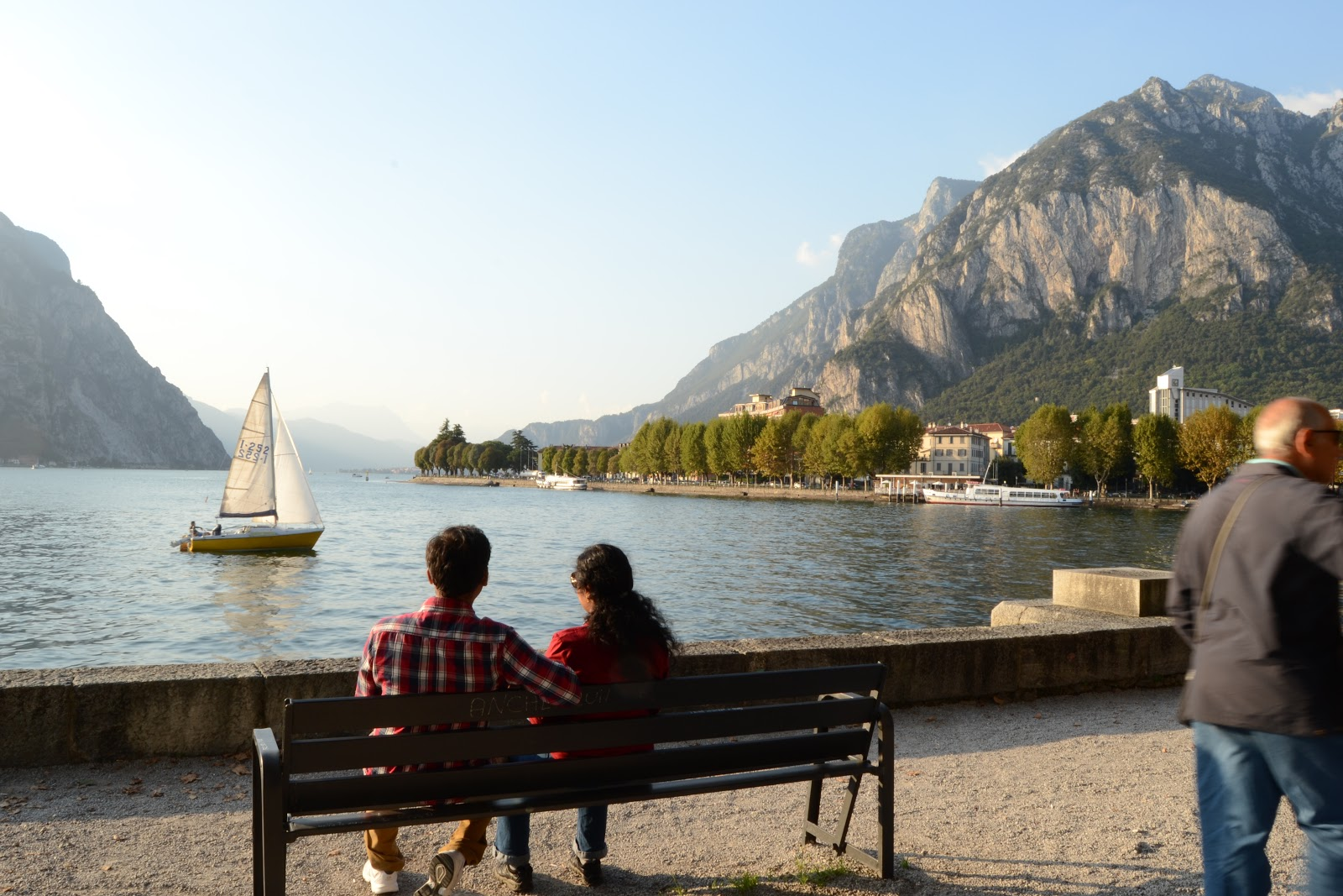 Couple viewing the sunset in Lecco, Lake and fun