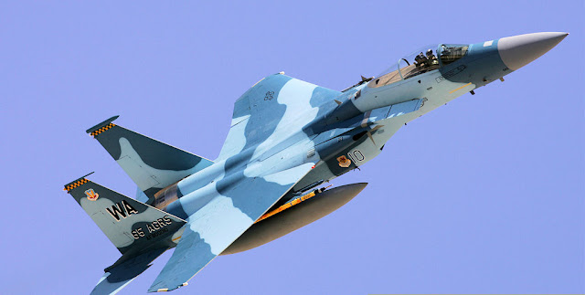 "Image Attribute: A file photo of F-15E with Sukhoi-27 ""Flankers"" Livery / Source: Wikipedia"