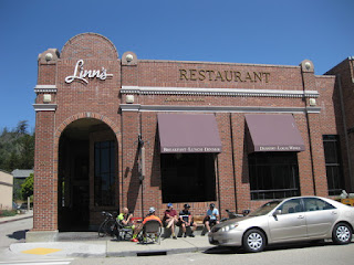 Cyclists congregate in front of Linn's restaurant, Cambria, California