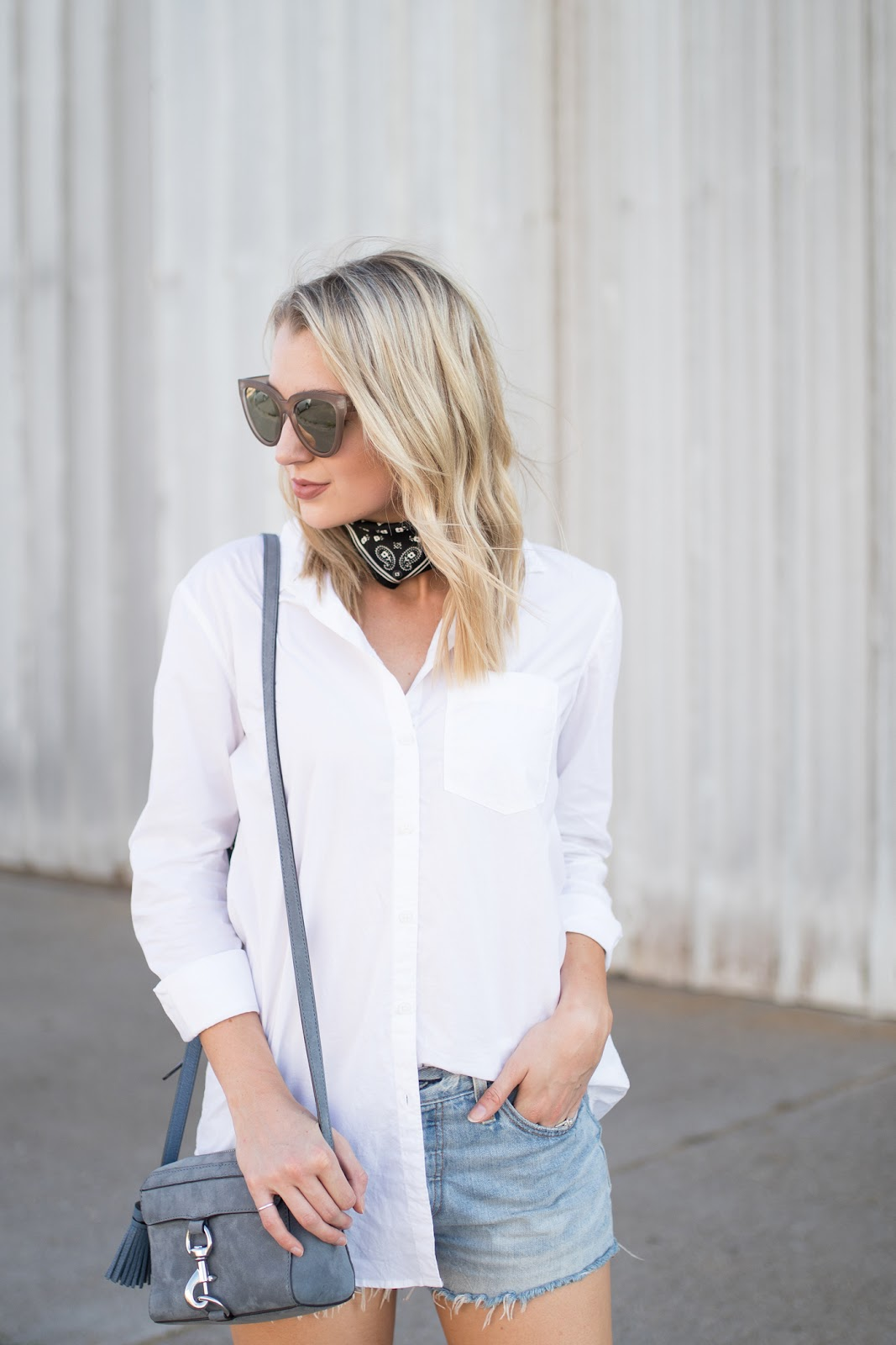 White button down, neck scarf, blue suede Rebecca Minkoff bag