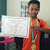 Peter Okoye celebrates his son, Cameron, for winning a medal as top scorer at his football academy