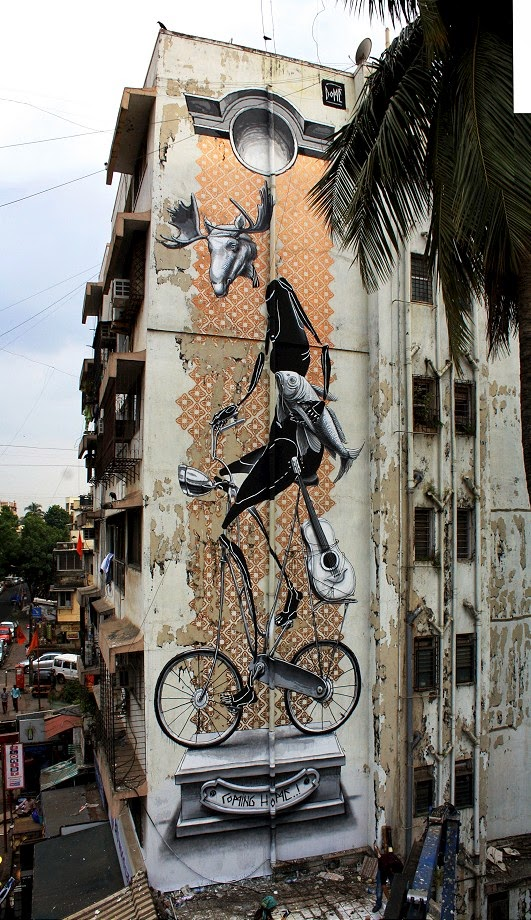"German artist Dome was recently in Mumbai, India, taking part in St+art India festival with this fantastic large mural entitled ""Coming Home""."