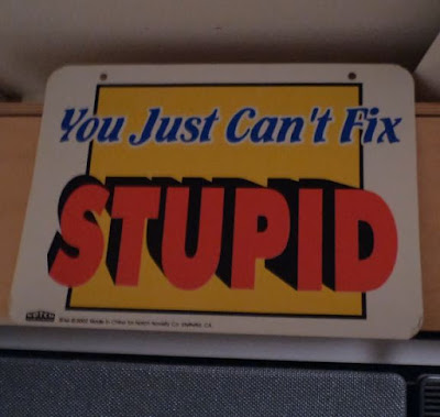 YOU JUST CAN'T FIX STUPID sign