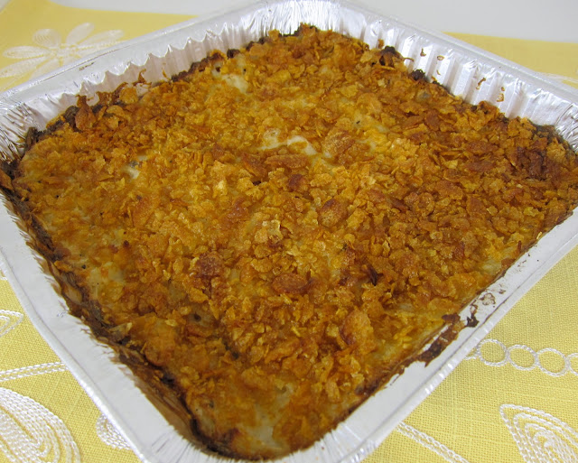 Creamy Potato Casserole - our favorite potato casserole! Frozen hash brown potatoes, chicken soup, mushroom soup, sour cream, top with crushed cornflakes. Great for a crowd/potluck. Freezes great for a quick side dish later!