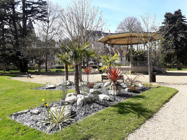 spring floral display by the bandstand in public garden in Loches