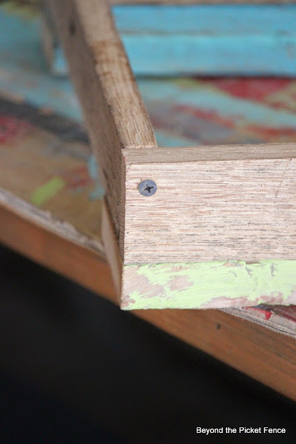 screwing the corners together on a tray made from salvaged wood