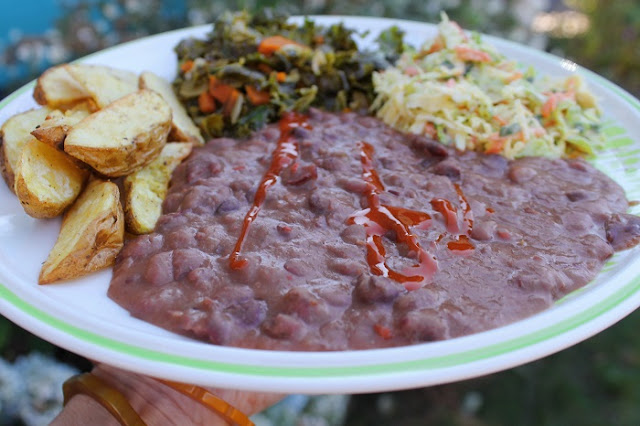 Red beans (and hot sauce), with air-fried potatoes, greens and coleslaw.