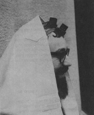 Sephardi wearing two pairs of tefillin