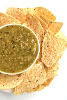 Green Salsa Verde is ready in 15 minutes and is loaded with flavor. Filled with fresh tomatillos, garlic, onions, cilantro and lime juice, it is sure to be a favorite sauce! www.nutritionistreviews.com