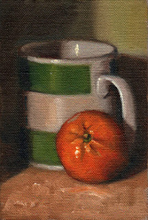 Oil painting of a mandarine beside a green and white Penguin-branded coffee mug