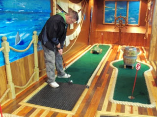 Richard Gottfried plays the indoor Adventure Golf course at the Fairworld Amusement Arcade in Cleethorpes