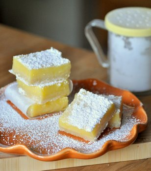 These lemon bars dusted with powdered sugar are decadent and sweet.