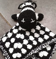 http://www.ravelry.com/patterns/library/ziggy-the-zebra-lovey---comforter