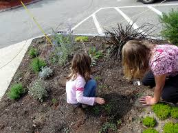 kids weeding flower garden