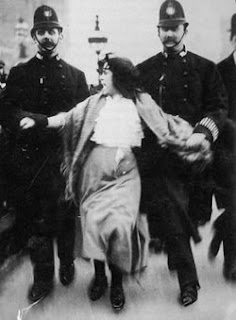 A young suffragette is arrested at the March 1907 protest.