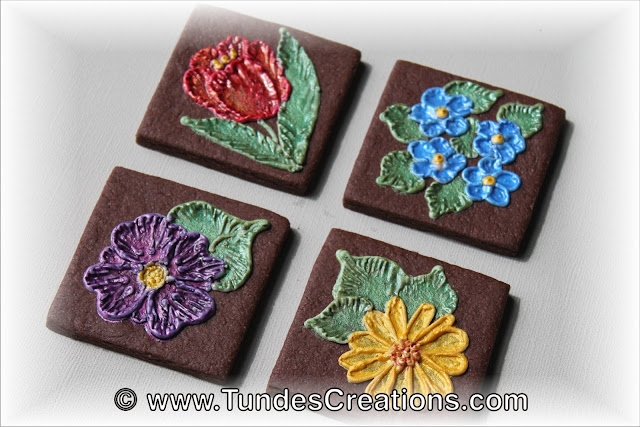 Chocolate square cookies with painted flowers by Tunde Dugantsi