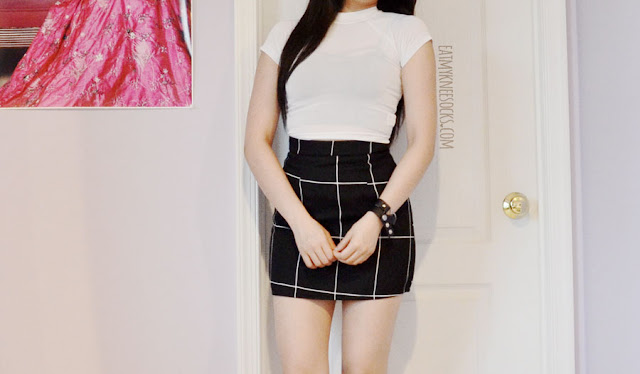 A monochrome, minimalist black-and-white American Apparel-esque Tumblr-style outfit featuring the grid print mini bodycon skirt from SheIn, paired with the UNIF white Plex Top and a Brandy Melville-style bralette.