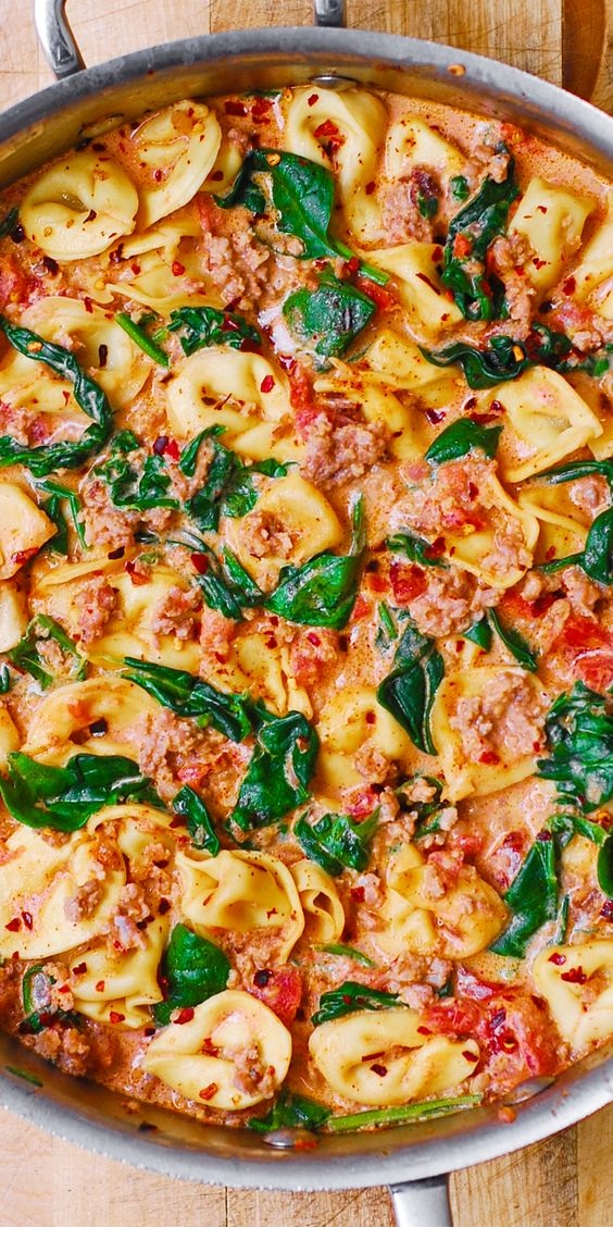 Creamy Sausage Tortellini with Spinach, Tomatoes and Mozzarella cheese sauce