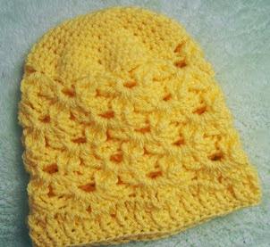 http://translate.google.es/translate?hl=es&sl=en&tl=es&u=http%3A%2F%2Fcats-rockin-crochet.blogspot.com.au%2F2014%2F02%2Flittle-petals-baby-beanie-free-crochet.html