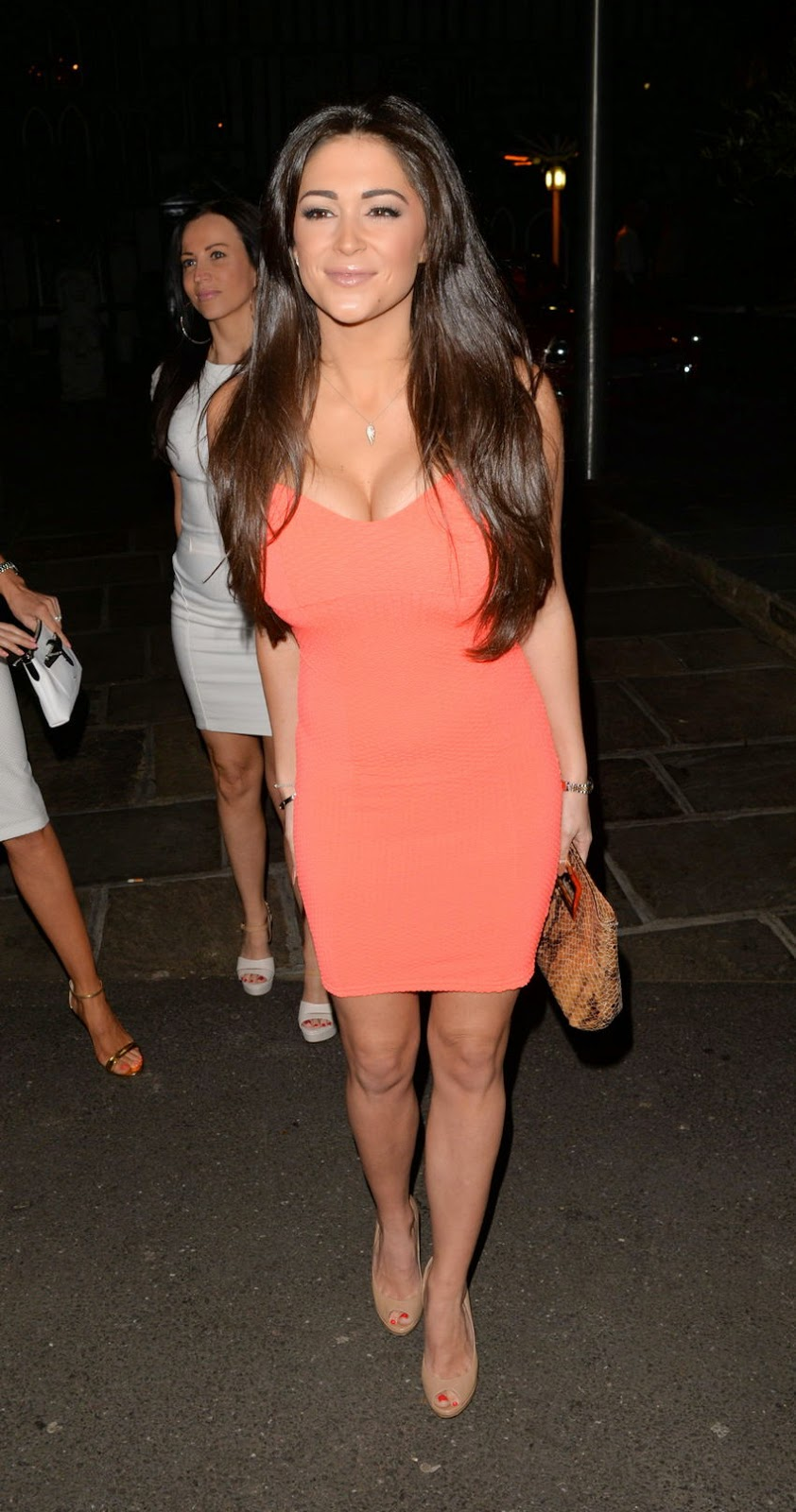 Sizzling curves in tight dress for Casey Batchelor during a night out