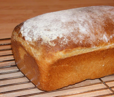 homemade basic white loaf, with floured top on baking rack
