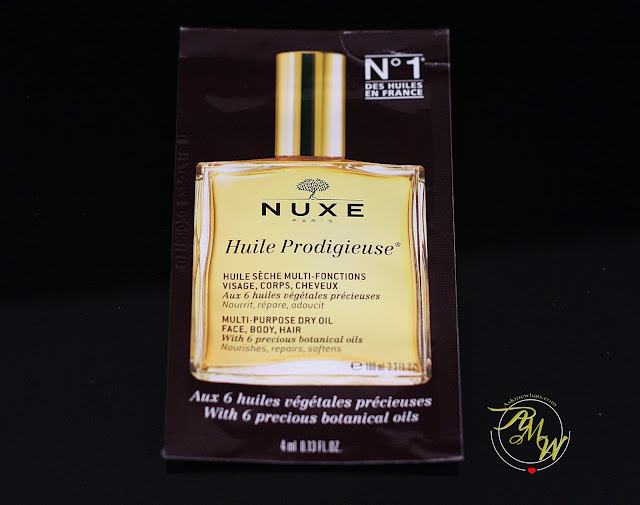 A photo of nuxe huile prodigieuse multi-purpose dry oil for face, body and hair