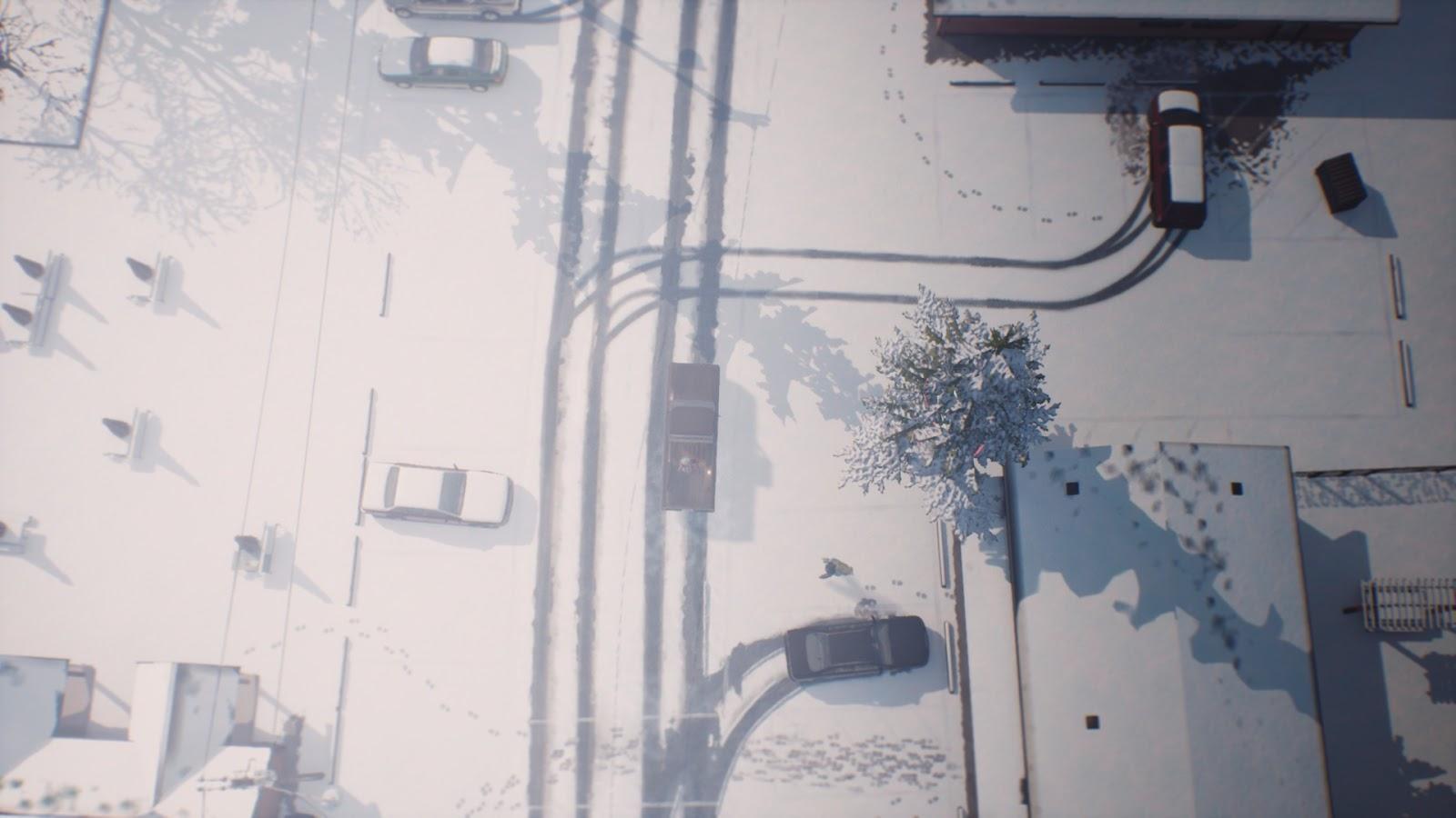 Hóval borított kisváros felülnézetből, elágazó keréknyomokkal.