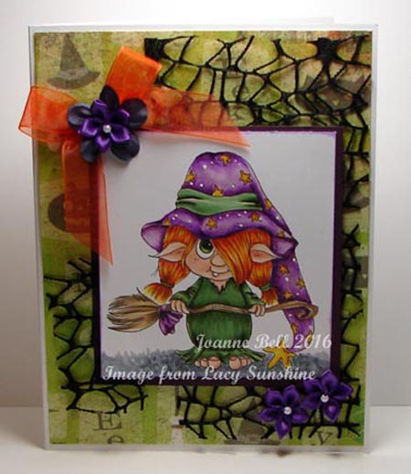 Coloured Troll, orange hair, purple hat with stars, black webbing and purple flowers