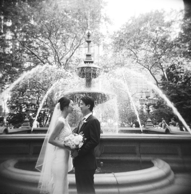 The bride and groom in front of a fountain in New York City | Karen Hill Photography