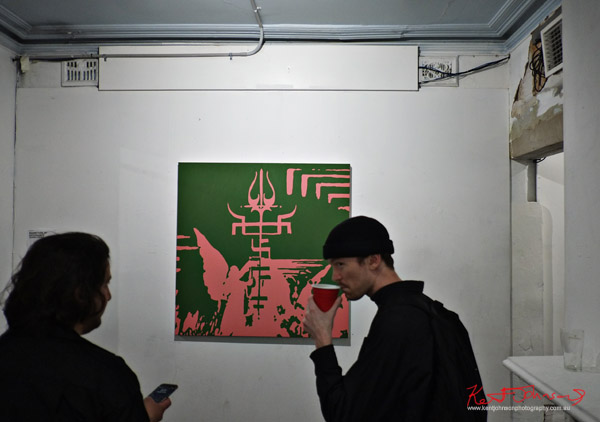 Green and Pink painting, symbols of two religions. Photographed by Kent Johnson for Street Fashion Sydney.