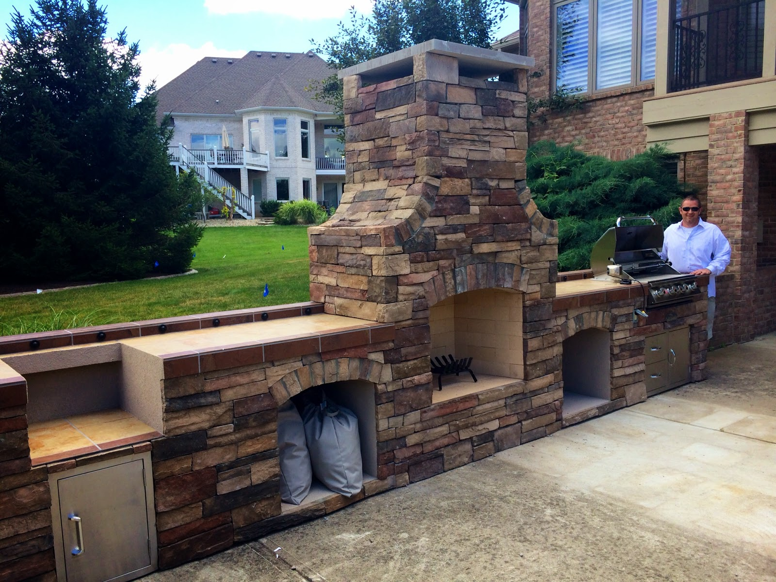 Outdoor Living: Outdoor Fireplace, Smoker, and Bull Angus ...
