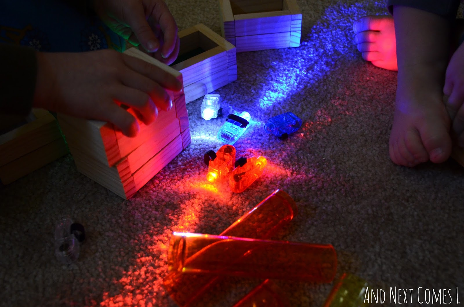 Light play for kids using finger lights and translucent objects from And Next Comes L