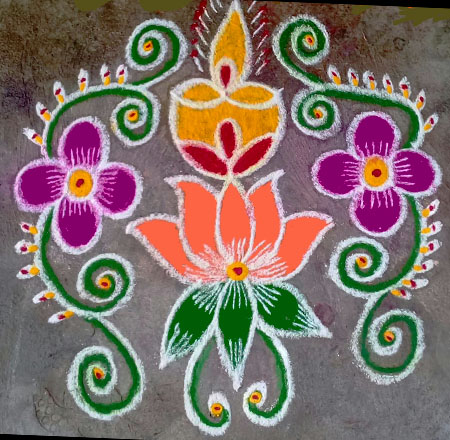 Make latest Flower With Diya Rangoli designs for Diwali